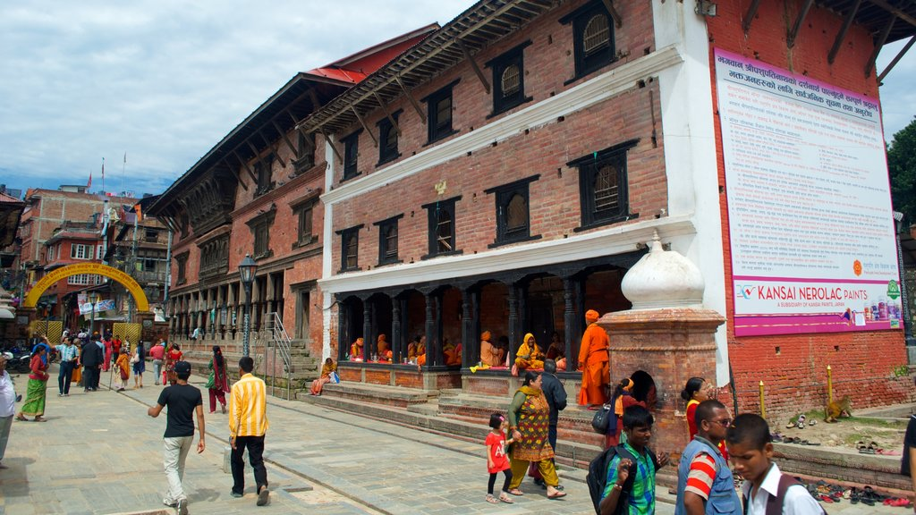 Pashupatinath Temple which includes a temple or place of worship as well as a small group of people