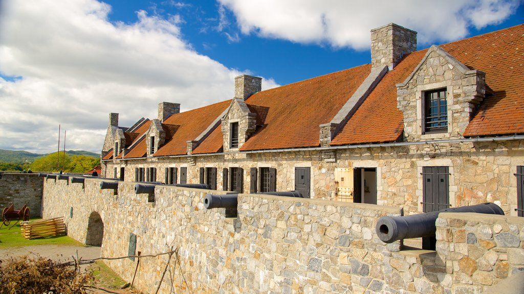 Fort Ticonderoga showing military items, chateau or palace and heritage elements