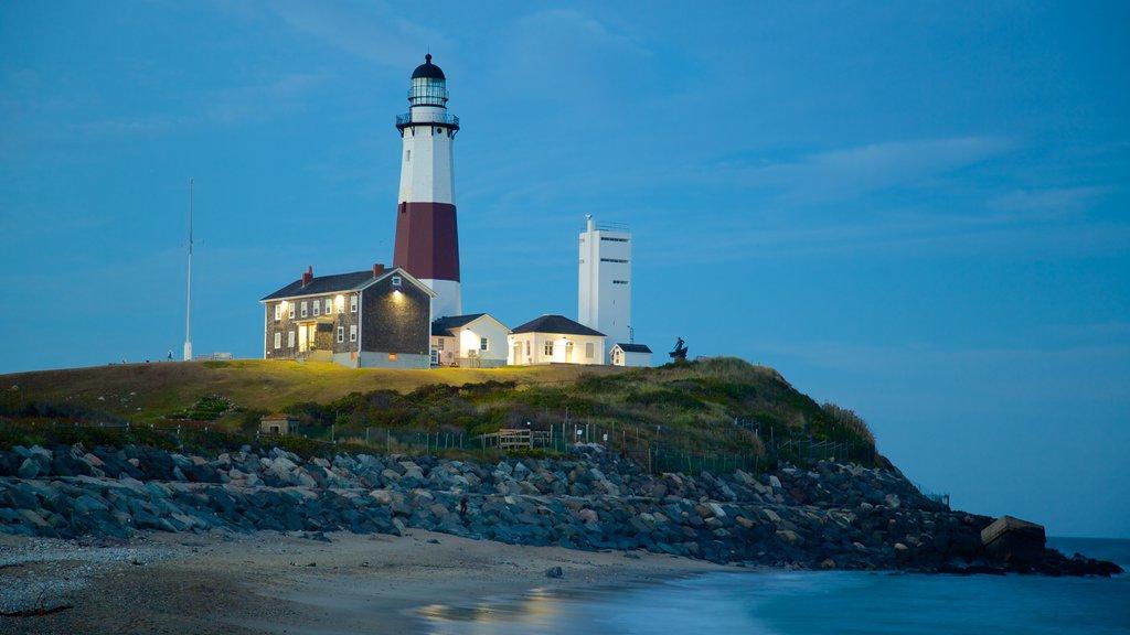 Montauk Point Lighthouse showing a beach, rocky coastline and a lighthouse