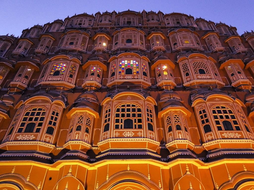 """Hawa Mahal - Lit up at night"" by Ronakshan1990 - Under Creative Commons license CC BY-SA 4.0 (https://creativecommons.org/licenses/by-sa/4.0/deed.en) - https://commons.wikimedia.org/wiki/File:Hawa_Mahal_-_Lit_up_at_night_-_1.jpg#"