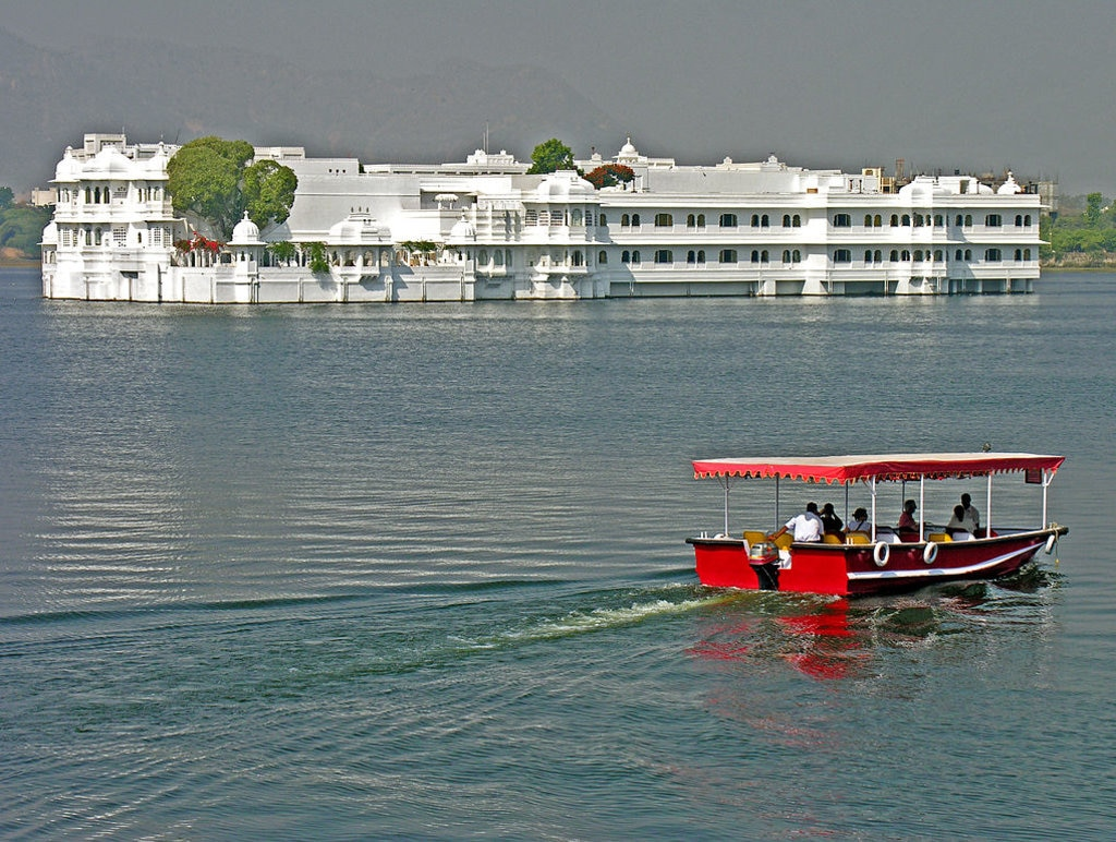 """Taj Lake Palace"" by Dennis Jarvis - Under Creative Commons license CC BY 2.0 (https://creativecommons.org/licenses/by/2.0/) - https://commons.wikimedia.org/wiki/File:Taj_Lake_Palace.jpg"