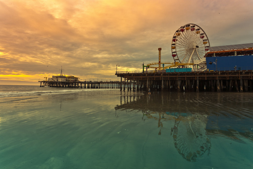 """Santa Monica pier ferris wheel"" by Boqiang Liao - Under Creative Commons license CC BY-SA 2.0 (https://creativecommons.org/licenses/by-sa/2.0/) - https://www.flickr.com/photos/martinliao/5259477485"