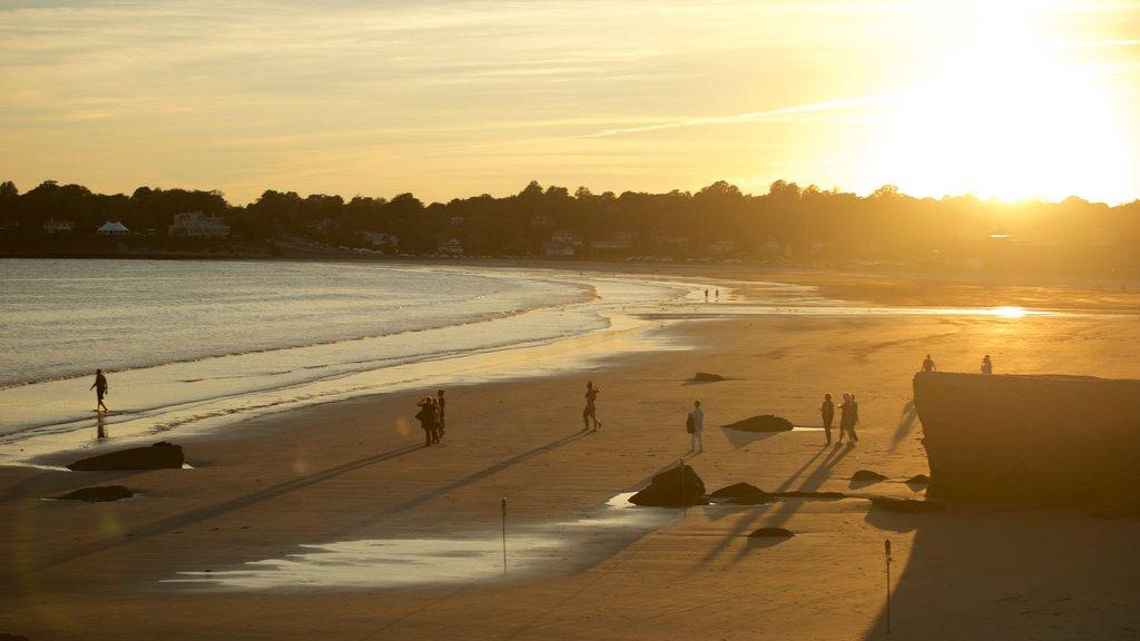 Easton\'s Beach featuring a sandy beach and a sunset