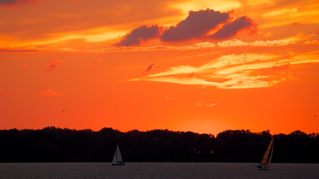 Erie which includes a lake or waterhole, a sunset and sailing