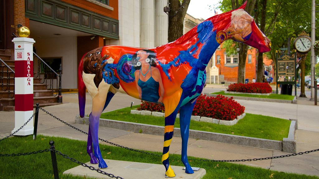 Saratoga Springs featuring outdoor art, a statue or sculpture and a city