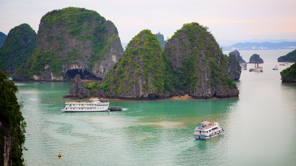 Halong Bay featuring mountains, a bay or harbor and boating