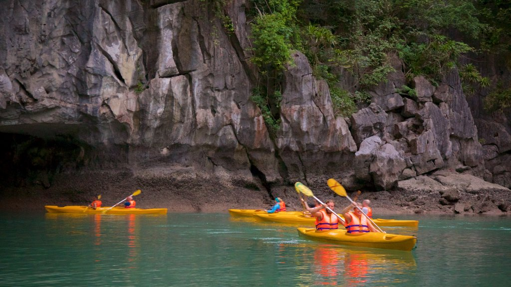 Halong Bay featuring a bay or harbor and kayaking or canoeing as well as a small group of people
