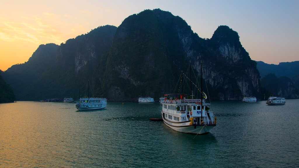 Halong Bay featuring a sunset, mountains and general coastal views