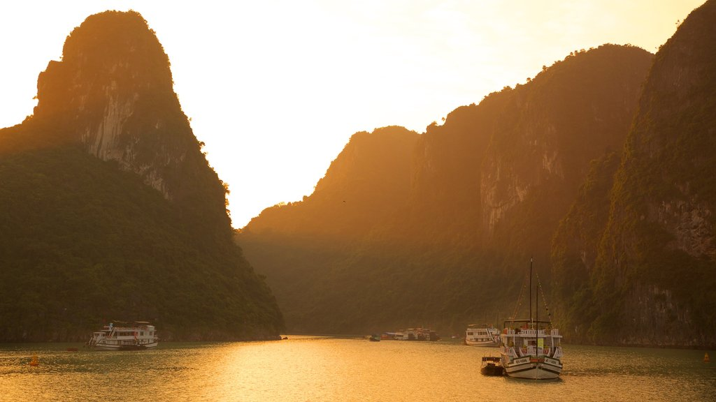 Halong Bay featuring a sunset and a bay or harbor