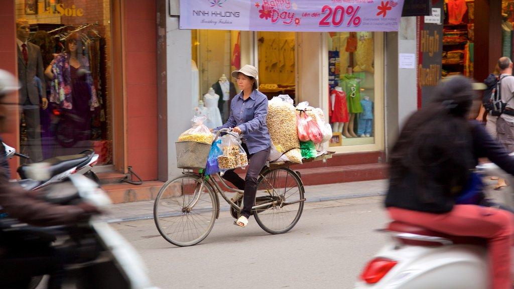 Hang Gai Street showing cycling as well as an individual femail