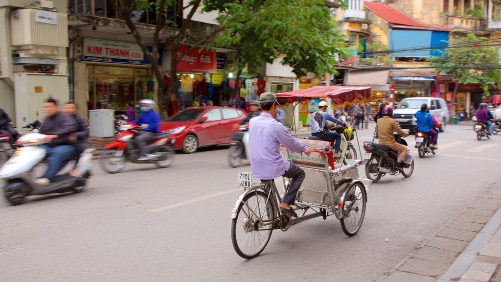 Hang Gai Street showing cycling and street scenes as well as a large group of people