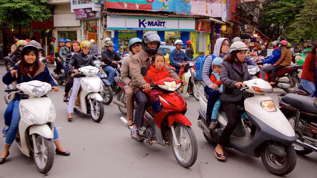 Hang Gai Street featuring street scenes as well as a large group of people
