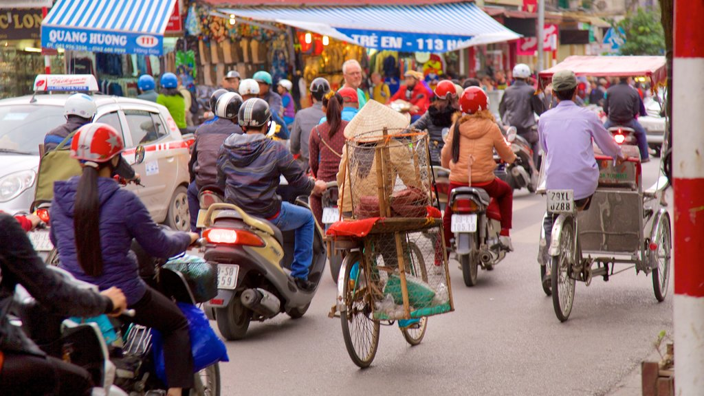 Hang Gai Street featuring cycling and street scenes as well as a large group of people