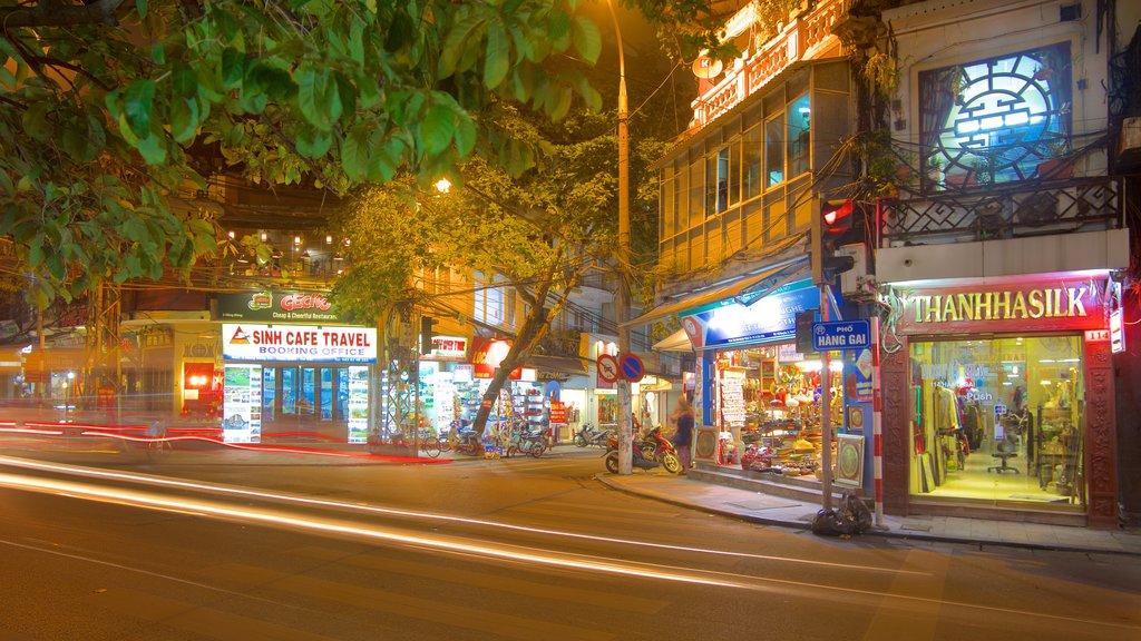 Hanoi showing signage, night scenes and street scenes