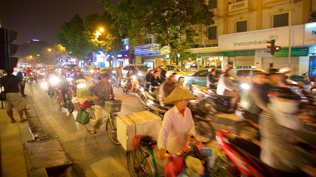 Hanoi showing street scenes and motorbike riding