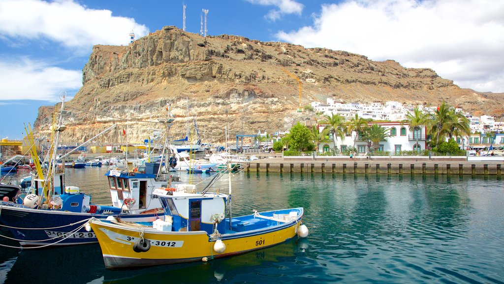 Mogan which includes a coastal town, boating and a bay or harbor