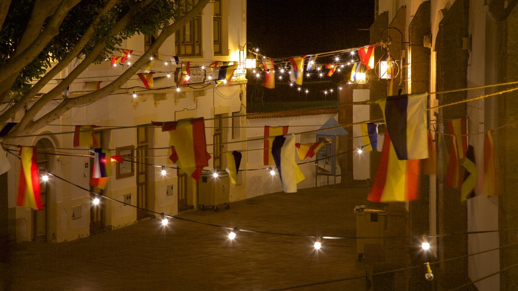 Tejeda which includes night scenes and a city