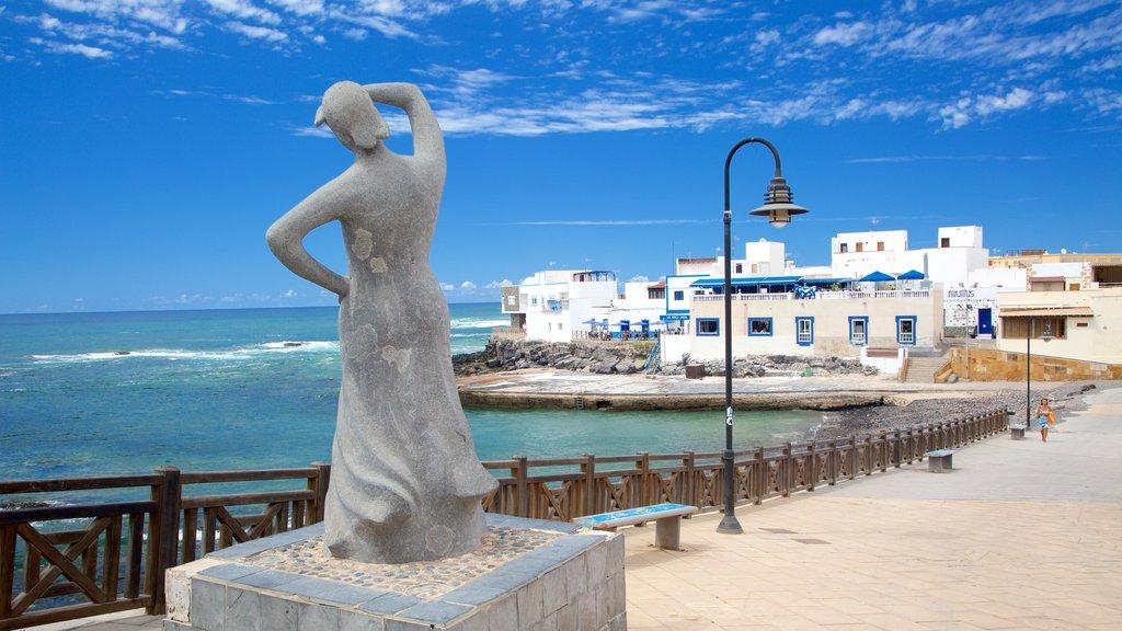El Cotillo which includes general coastal views, a statue or sculpture and a coastal town