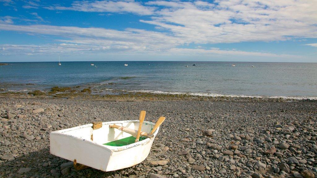 Playa Barca showing boating, general coastal views and a pebble beach