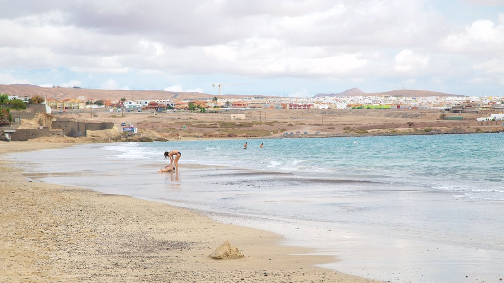 Puerto del Rosario featuring a beach, swimming and a coastal town