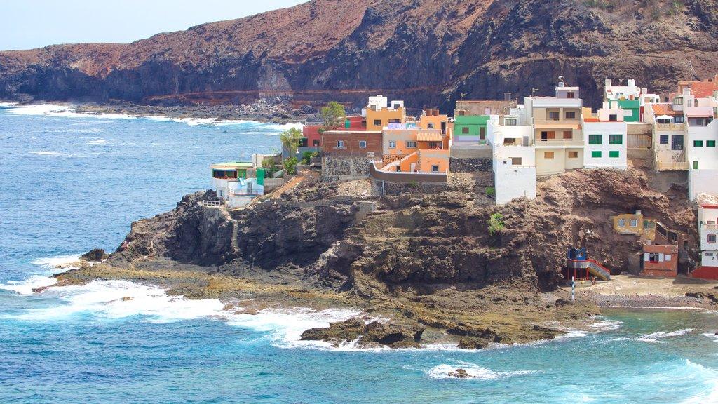 Gran Canaria which includes rocky coastline, general coastal views and a coastal town
