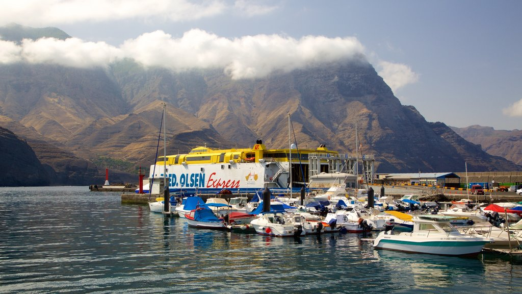 Agaete which includes a bay or harbor, boating and mountains