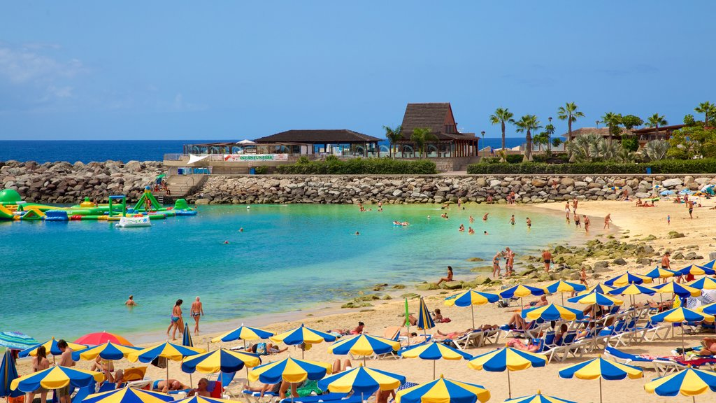 Amadores Beach showing a luxury hotel or resort, general coastal views and a sandy beach