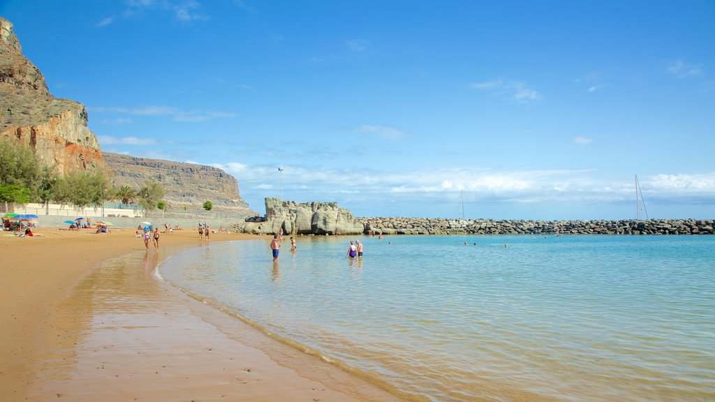 Playa de Mogan showing swimming, a beach and general coastal views