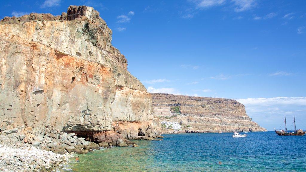 Playa de Mogan which includes island views, boating and rugged coastline