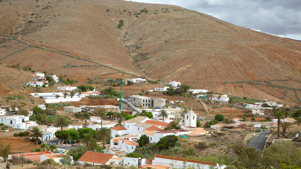 Betancuria which includes a small town or village and desert views
