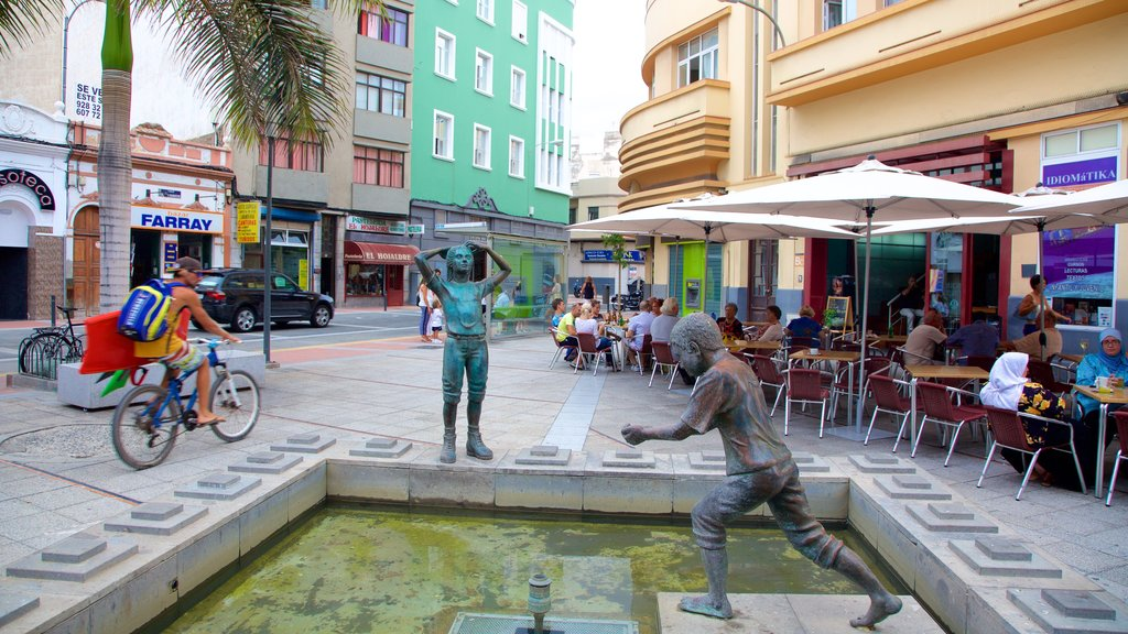 Las Palmas de Gran Canaria showing a statue or sculpture, a city and outdoor eating