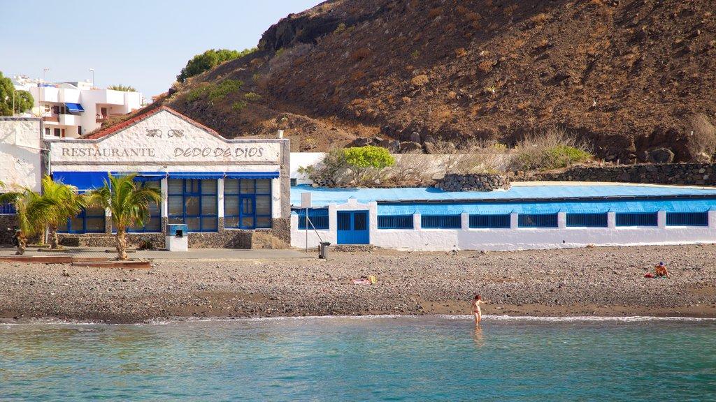Agaete featuring a pebble beach, a coastal town and general coastal views