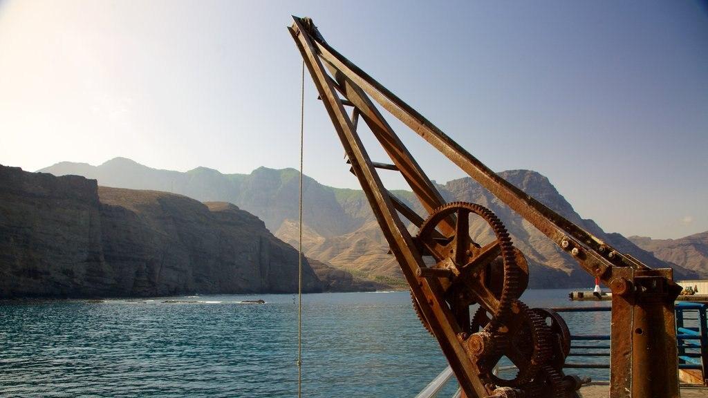 Agaete which includes general coastal views, boating and rugged coastline