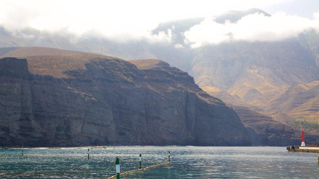 Agaete featuring rugged coastline, mist or fog and mountains