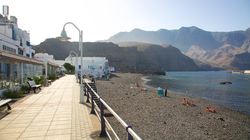 Agaete featuring rocky coastline, a small town or village and general coastal views