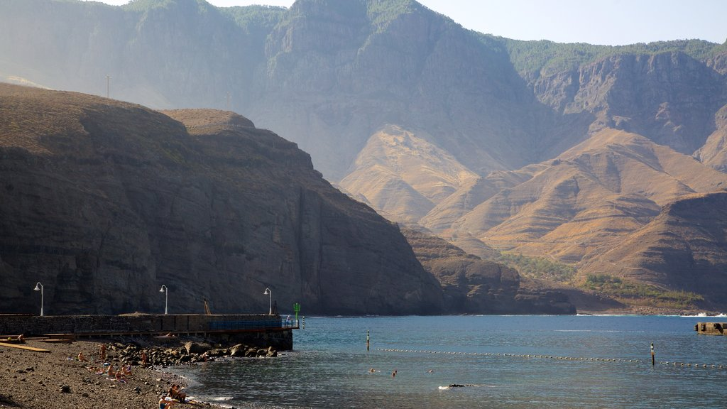 Agaete which includes general coastal views, mountains and rugged coastline