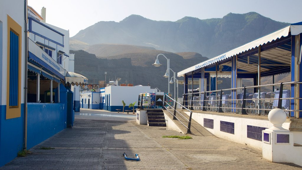 Agaete featuring mountains and a small town or village