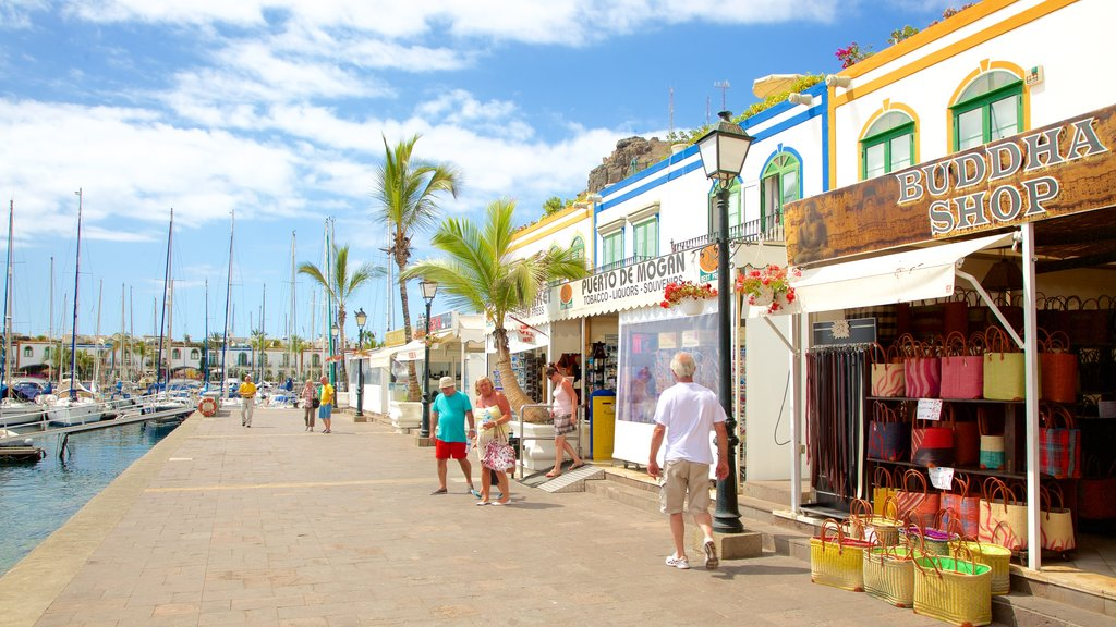 Mogan which includes boating, a bay or harbor and shopping