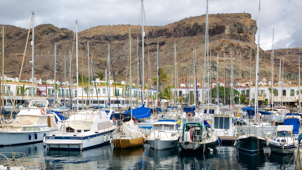Mogan showing a gorge or canyon, boating and a bay or harbor