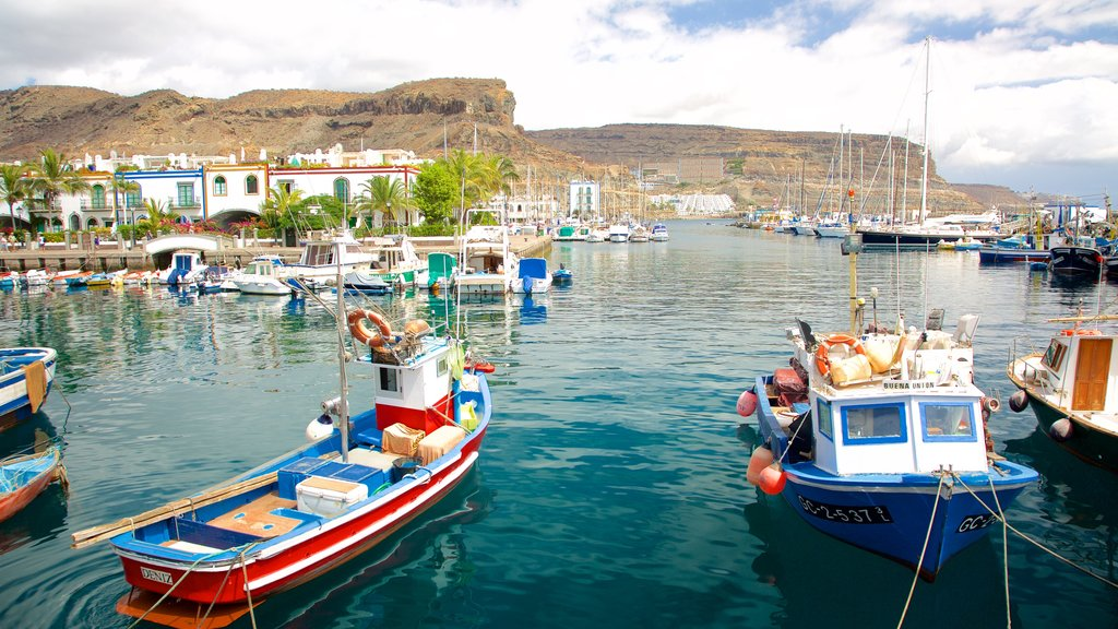 Mogan which includes a bay or harbor, boating and general coastal views