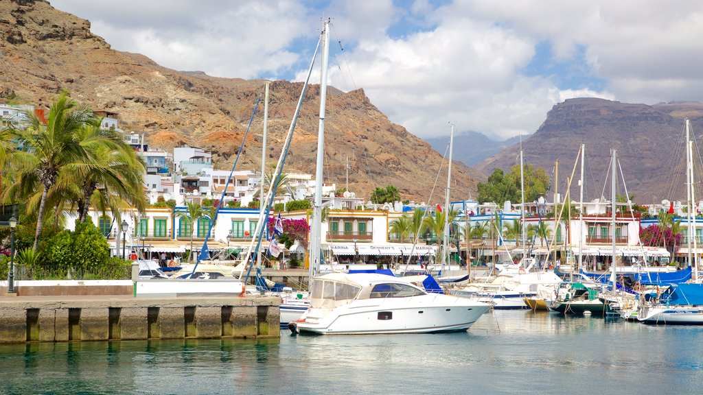 Mogan featuring boating, a gorge or canyon and a bay or harbor