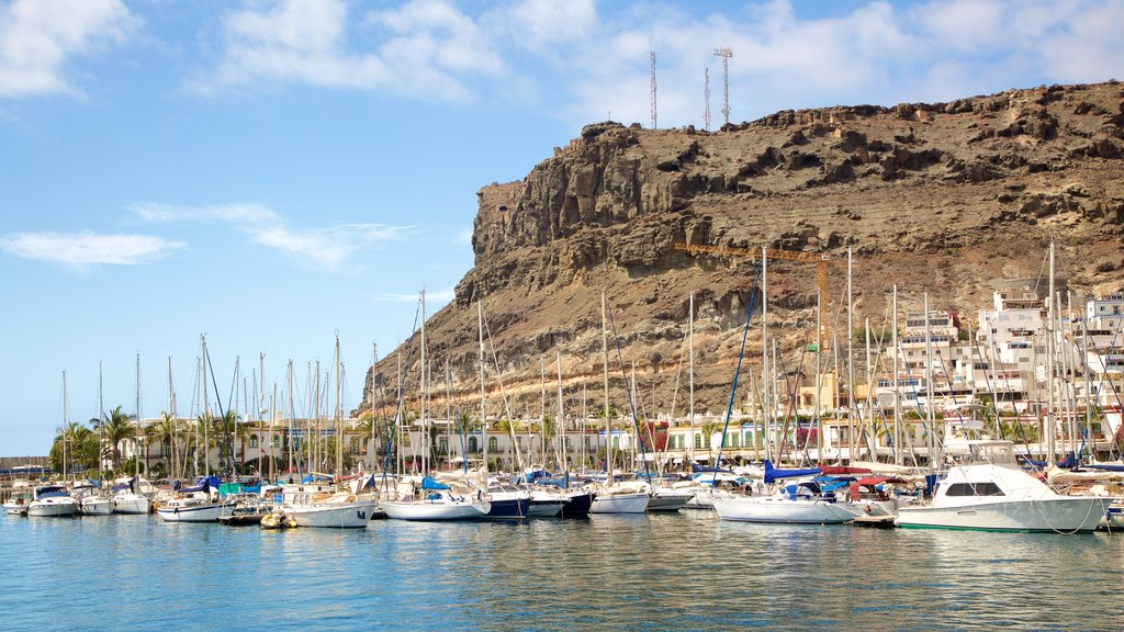 Mogan which includes boating, rocky coastline and a bay or harbor