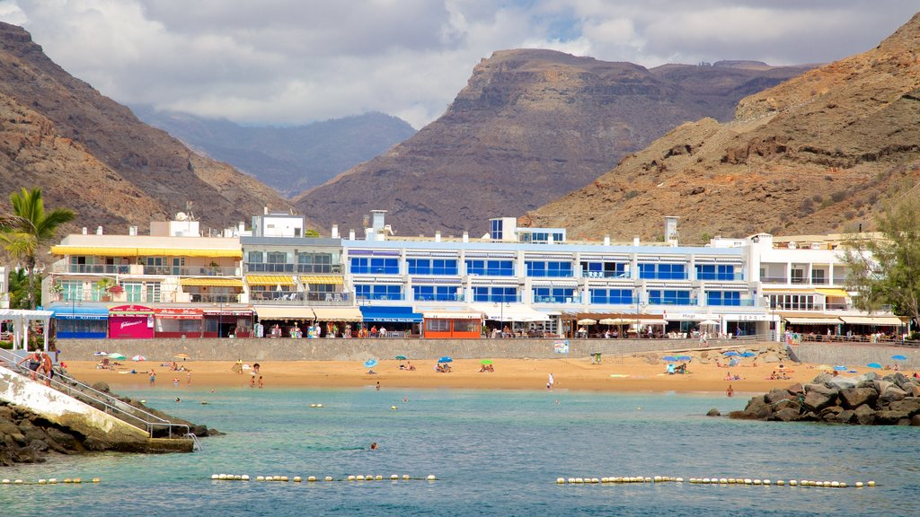 Mogan which includes general coastal views, a gorge or canyon and a coastal town