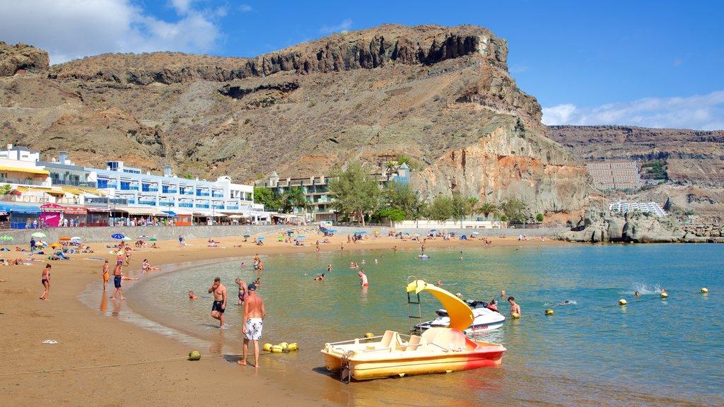 Playa de Mogan featuring general coastal views, swimming and rugged coastline