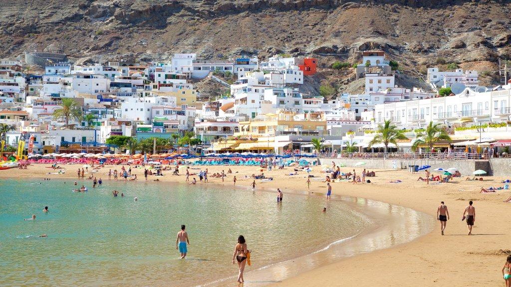 Playa de Mogan featuring general coastal views, a sandy beach and a coastal town