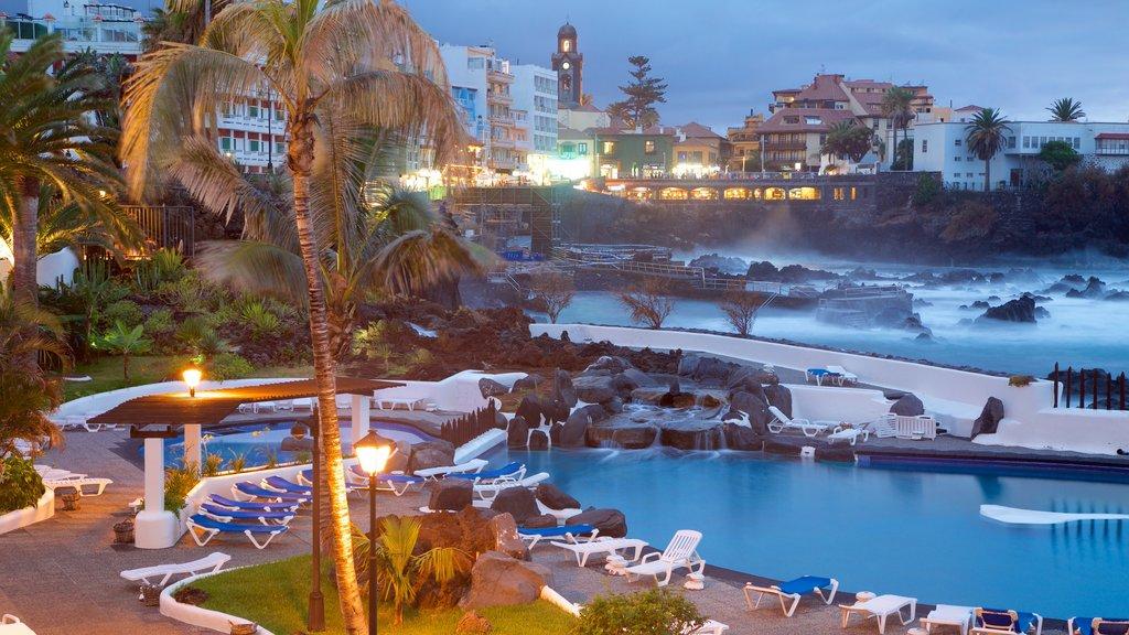 Puerto de la Cruz which includes a luxury hotel or resort, a pool and a coastal town