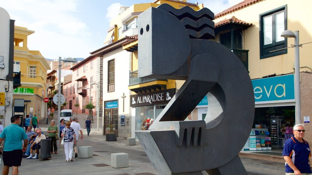 Puerto de la Cruz which includes a square or plaza and a statue or sculpture