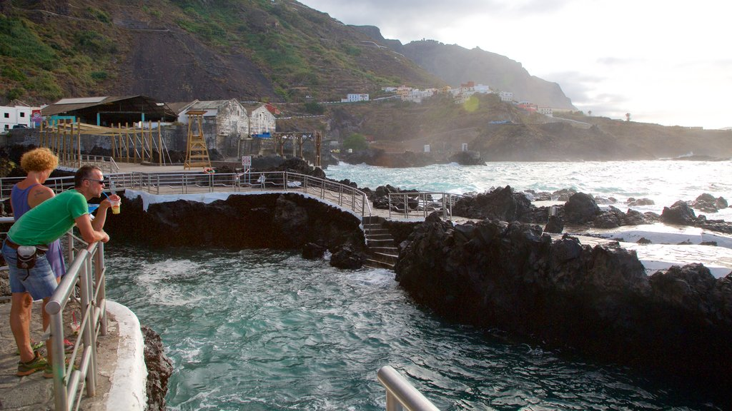 Garachico which includes rocky coastline and general coastal views as well as a couple