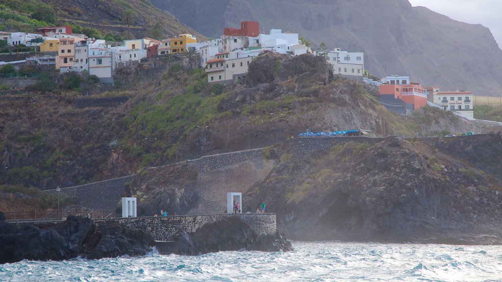 Garachico showing rocky coastline and a coastal town
