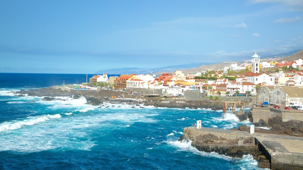 Garachico showing rugged coastline, surf and a coastal town